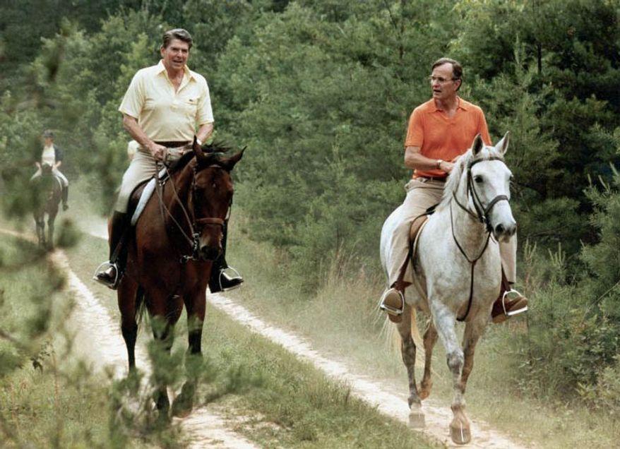 ** FILE ** U.S. President Ronald Reagan, left, and Vice President George Bush go horseback riding at Camp David, Md., July 1981. (Associated Press)