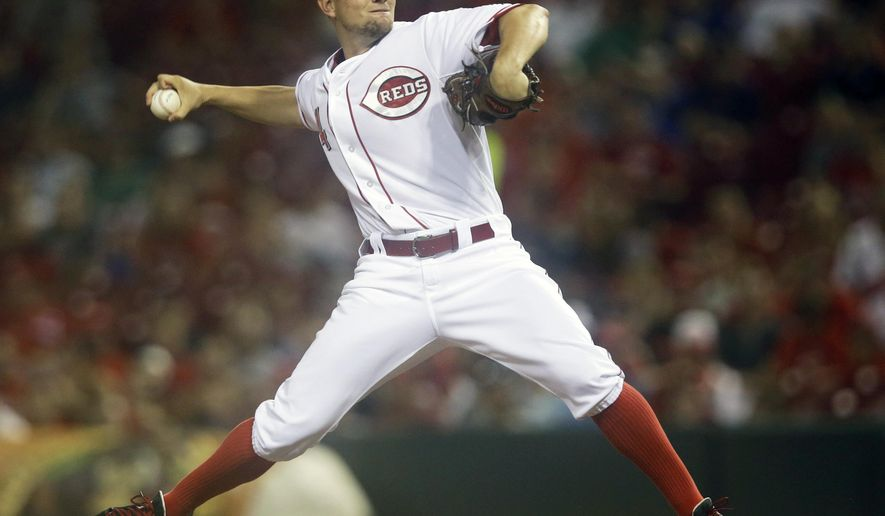 Cincinnati Reds starting pitcher Mike Leake throws against the Atlanta Braves in the first inning of a baseball game, Saturday, Aug. 23, 2014, in Cincinnati. (AP Photo/Al Behrman)