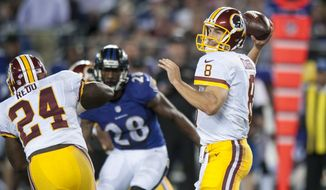 Washington Redskins' quarterback Kirk Cousins passes during the fourth quarter against the Baltimore Ravens during their pre-season game at M&T Bank Stadium on August 23, 2014 in Baltimore, Maryland. Baltimore won the game 23-17. (Pete Marovich Special to The Washington Times)