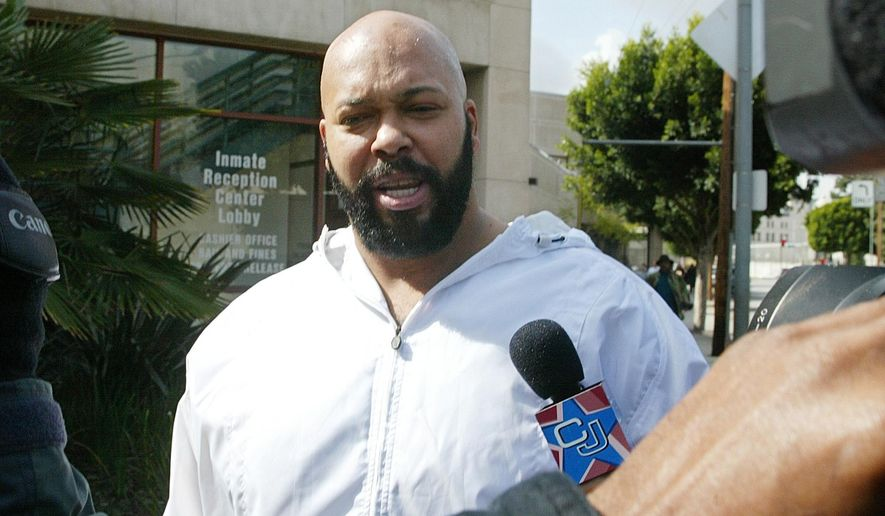"FILE - In a Feb. 26, 2003 file photo, rap music mogul Marion ""Suge' Knight walks out of the Los Angeles County jail, in Los Angeles. Knight has been injured in an early morning shooting Sunday, Aug. 24, 2014, at a West Hollywood nightclub but is expected to survive. Sgt. C. Tatar, watch commander at the Los Angeles County sheriff department's West Hollywood station, says the 49-year-old Knight and two others were hit at the 1OAK club around 1:30 a.m. Authorities say the club was packed at the time, and they are still seeking a suspect. The other victims were a man and a woman. (AP Photo/Damian Dovarganes, File)"