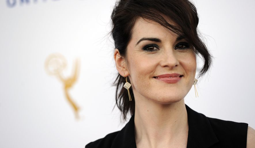 "Michelle Dockery, an Emmy nominee for lead actress in a drama series for ""Downton Abbey,"" poses at the 66th Emmy Awards Performers Nominee Reception on Saturday, Aug. 23, 2014, in West Hollywood, Calif. (Photo by Chris Pizzello/Invision/AP)"
