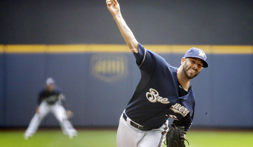 Milwaukee Brewers starting pitcher Mike Fiers throws during the first inning of a baseball game against the Pittsburgh Pirates, Sunday, Aug. 24, 2014, in Milwaukee. (AP Photo/Morry Gash)