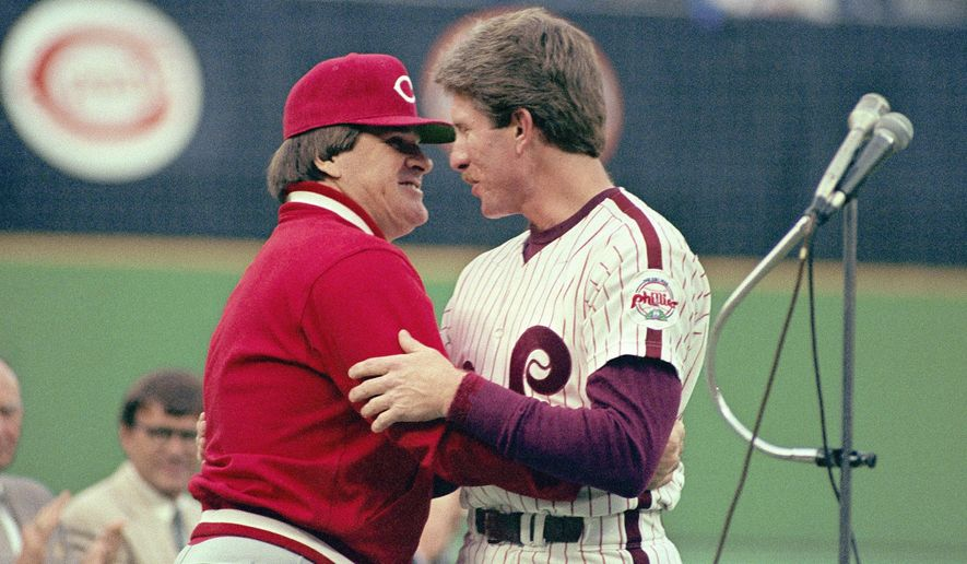 FILE - In this May 2, 1987, file photo, Philadelphia Phillies' Mike Schmidt, right, is congratulated by Cincinnati Reds manager and former teammate Pete Rose during a pregame ceremony honoring Schmidt for hitting his 500th home run, in Philadelphia. On the 25th anniversary of Rose's banishment from baseball, Schmidt says it is time to forgive him and put him in the Hall of Fame. (AP Photo/David Fields, File)