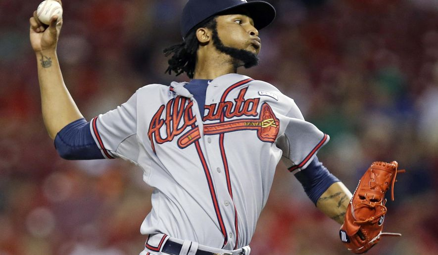 Atlanta Braves starting pitcher Ervin Santana throws against the Cincinnati Reds in the first inning of a baseball game, Saturday, Aug. 23, 2014, in Cincinnati. (AP Photo/Al Behrman)