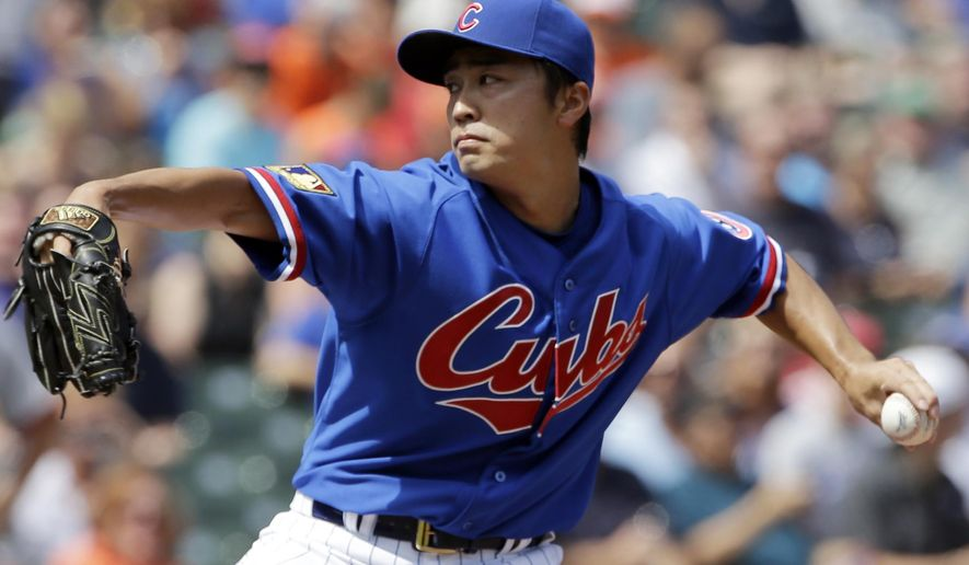 Chicago Cubs starter Tsuyoshi Wada, of Japan, throws against the Baltimore Orioles during the first inning of an interleague baseball game in Chicago, Sunday, Aug. 24, 2014. (AP Photo/Nam Y. Huh)