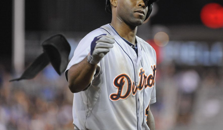 Detroit Tigers' Tori Hunter throws his arm guards to the side and heads to first base after being hit by a pitch from Minnesota Twins pitcher Samuel Deduno during the eighth inning of a baseball game Saturday, Aug. 23, 2014 in Minneapolis. The Tigers won 8-6. (AP Photo/Craig Lassig)
