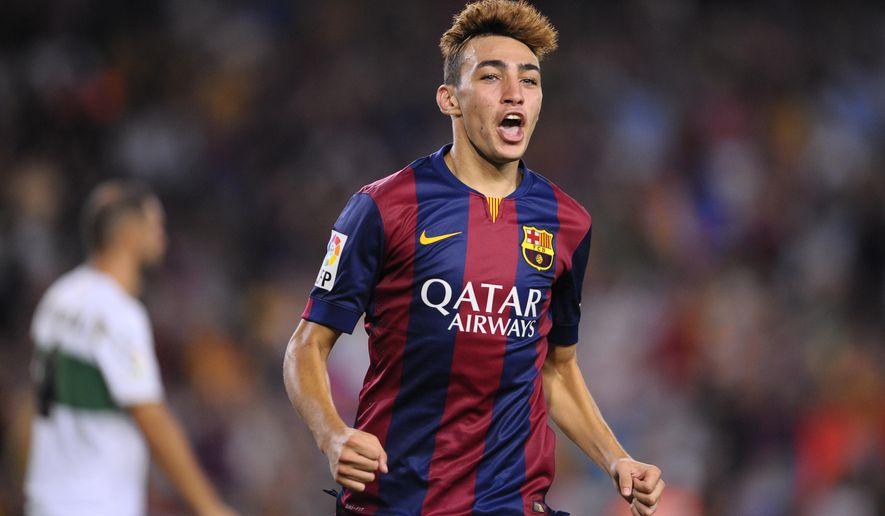 FC Barcelona's Munir reacts after scoring against Elche during a Spanish La Liga soccer match at the Camp Nou stadium in Barcelona, Spain, Sunday, Aug. 24, 2014. (AP Photo/Manu Fernandez)