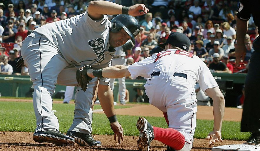 Boston Red Sox's Brock Holt tags out Seattle Mariners' Kendrys Morales, left, at third base after Kyle Seager reached on an infield single in the first inning of a baseball game in Boston, Sunday, Aug. 24, 2014. (AP Photo/Michael Dwyer)