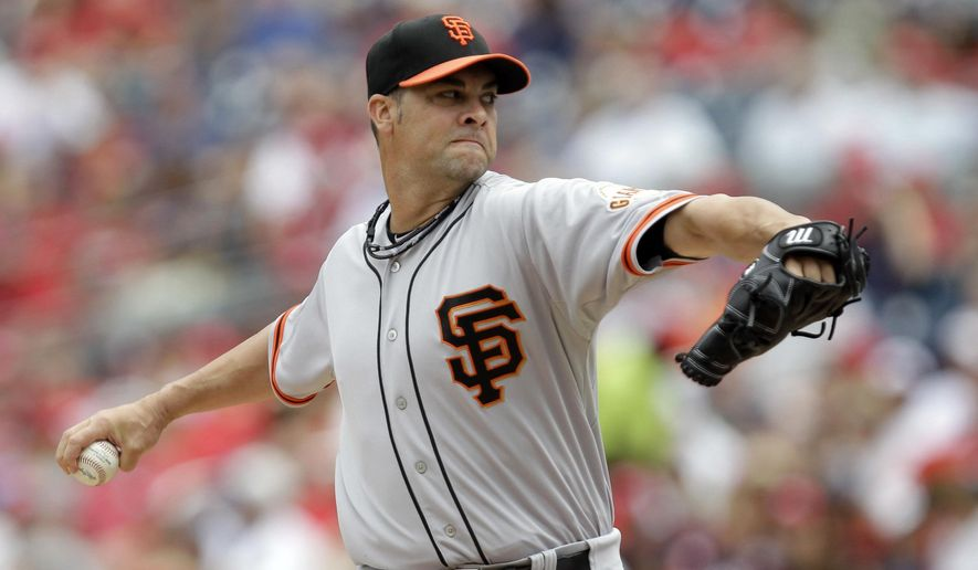 San Francisco Giants pitcher Ryan Vogelsong delivers during the first inning of a baseball game against the Washington Nationals, Sunday, Aug. 24, 2014, in Washington. (AP Photo/Luis M. Alvarez)