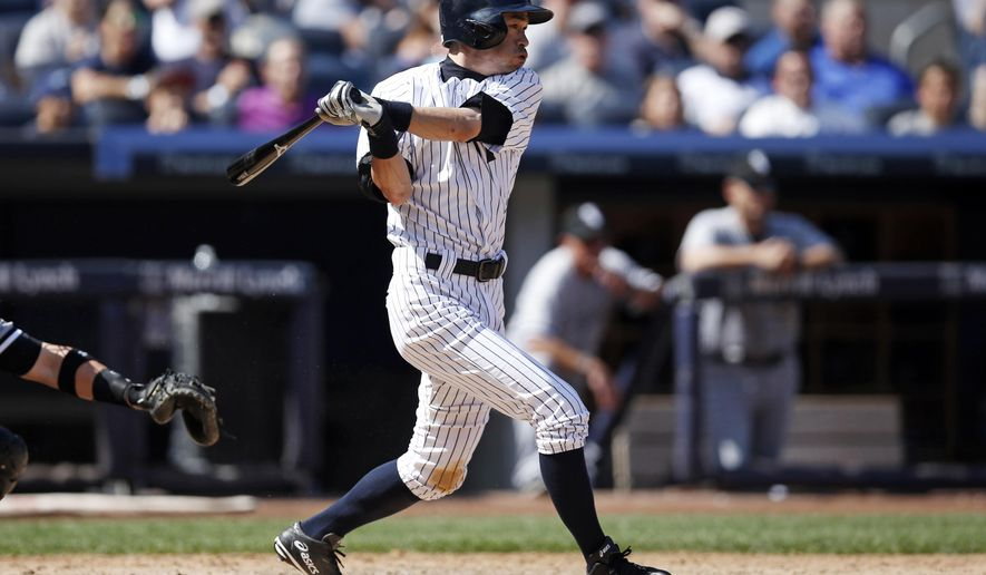 New York Yankees Ichiro Suzuki hits a sixth-inning, two-run, single off Chicago White Sox starting pitcher Chris Sale in a baseball game at Yankee Stadium in New York, Sunday, Aug. 24, 2014.  (AP Photo/Kathy Willens)