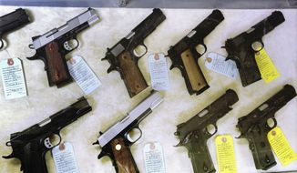 A Virginia state Senate panel on Wednesday advanced a modified version of a bill that would prevent people convicted of domestic abuse crimes from possessing or transporting a gun. (AP Photo/Seth Perlman, File)
