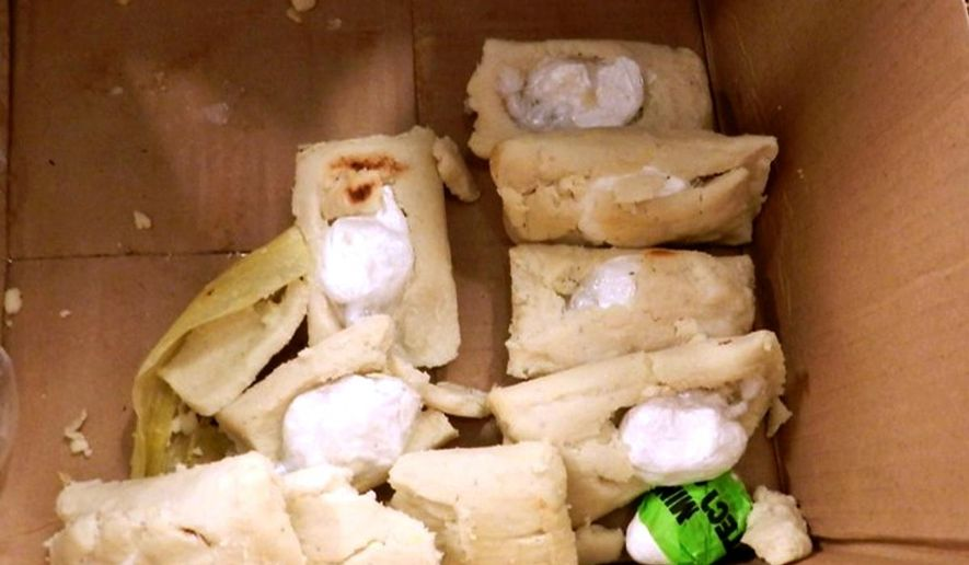A photo provided by the U.S. Customs and Border Protection shows tamales stuffed with several ounces of cocaine discovered at the at George Bush Intercontinental Airport in Houston, being transported by a man from El Salvador. (AP Photo/US Customs and Border Protection) ** FILE **