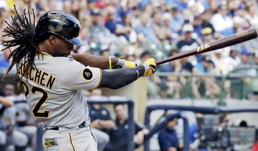 Pittsburgh Pirates' Andrew McCutchen hits a home run during the ninth inning of a baseball game against the Milwaukee Brewers, Sunday, Aug. 24, 2014, in Milwaukee. (AP Photo/Morry Gash)