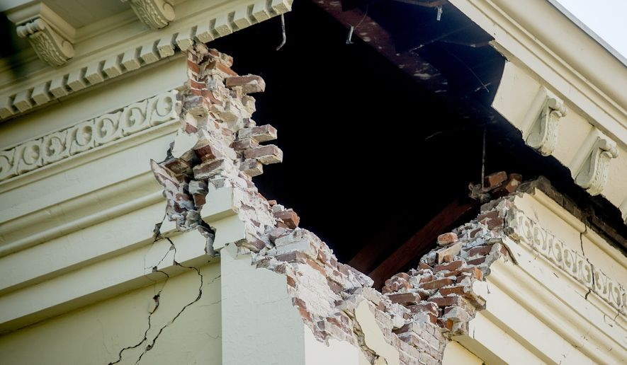 A corner of the historic Napa County Courthouse sits exposed following an earthquake Sunday, Aug. 24, 2014, in Napa, Calif. Officials in the city of Napa say 15 to 16 buildings are no longer inhabitable after Sunday's magnitude-6.0 earthquake, and there is only limited access to numerous other structures. (AP Photo/Noah Berger)