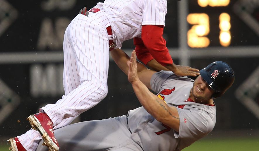 St Louis Cardinals' Matt Holliday, bottom, is out at second and Philadelphia Phillies' Jimmy Rollins throws to first on a ground ball hit by Cardinals' Matt Adams in the first inning of a baseball game, Saturday, Aug. 23, 2014, in Philadelphia. (AP Photo/Laurence Kesterson)