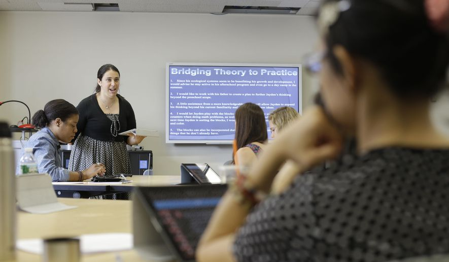 **FILE** In this Wednesday, June 25, 2014 file photo, Dr. Lindsay Portnoy leads a class in early childhood development at Hunter College in New York. (AP Photo/Frank Franklin, File)