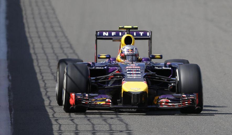 Red Bull driver Daniel Ricciardo of Australia leads during the Belgium Formula One Grand Prix at the Spa-Francorchamps circuit, Belgium, Sunday, Aug. 24, 2014.  (AP Photo/Luca Bruno)