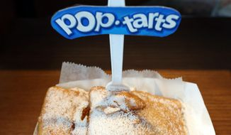 Deep fried Pop-Tarts are on display at a food vendor at the Washington County Fair on Thursday, Aug. 21, 2014, in Greenwich, N.Y. The creators of fair concoctions say they work all year to outdo themselves and the other vendors vying for the attention of an ever more expectant public. (AP Photo/Mike Groll)
