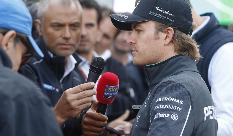 Mercedes driver Nico Rosberg of Germany answers reporters after the Belgium Formula One Grand Prix at the Spa-Francorchamps circuit, Belgium, Sunday, Aug. 24, 2014. The increasingly strained relations at Mercedes look set to get even worse after Rosberg effectively ended Hamilton's race chances with a risky overtaking move that saw him clip and puncture the Briton's left tire. (AP Photo/Luca Bruno)