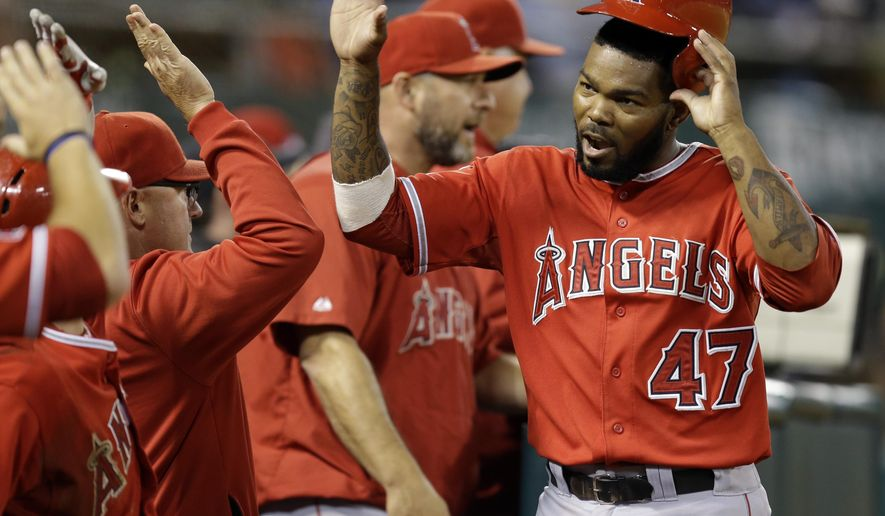 Los Angeles Angels' Howie Kendrick (47) is congratulated after scoring against the Oakland Athletics in the seventh inning of a baseball game Saturday, Aug. 23, 2014, in Oakland, Calif. Kendrick scored on a single by Erick Aybar. (AP Photo/Ben Margot)
