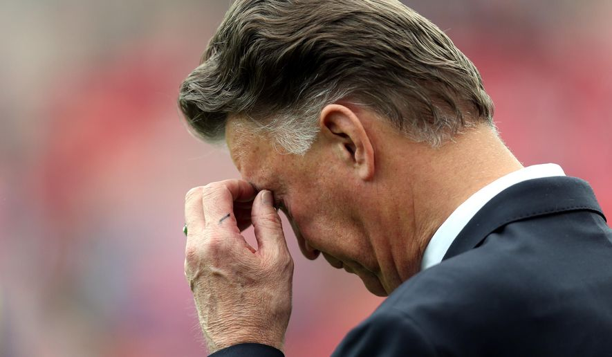 Manchester United's manager Louis Van Gaal looks on ahead of their English Premier League soccer match against Sunderland at the Stadium of Light, Sunderland, England, Sunday, Aug. 24, 2014. (AP Photo/Scott Heppell)