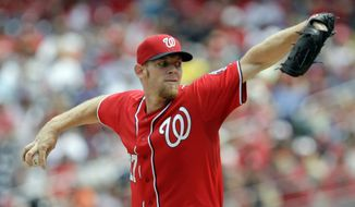 Washington Nationals pitcher Stephen Strasburg delivers during the first inning of a baseball game against the San Francisco Giants, Sunday, Aug. 24, 2014, in Washington. (AP Photo/Luis M. Alvarez)
