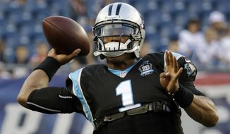 Carolina Panthers quarterback Cam Newton warms up before an NFL preseason football game against the New England Patriots, Friday, Aug. 22, 2014, in Foxborough, Mass. (AP Photo/Stephan Savoia)