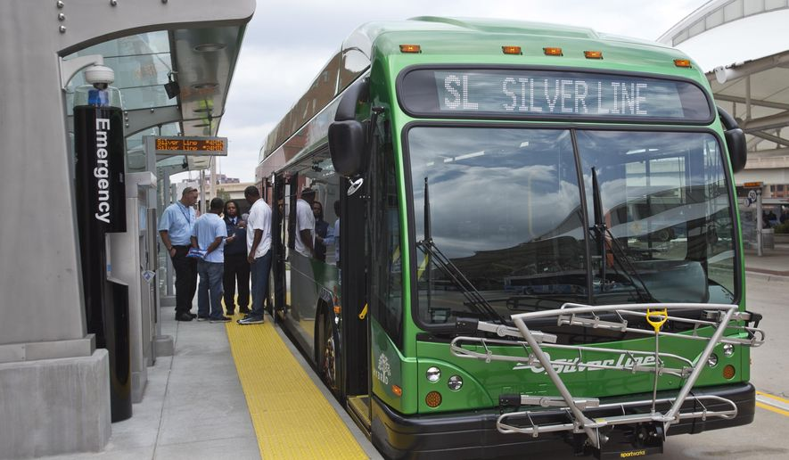 In a Monday, Aug. 18, 2014 photo, drivers prepare get on a new Silver Line bus during a training exercise in Grand Rapids, Mich. Grand Rapids is launching a $40 million rapid transit bus system that connects the city center with southern suburbs. The system cuts a typical 45-minute drive to a 27-minute commute, according to transportation planners. (AP Photo/The Grand Rapids Press,Cory Morse) ALL LOCAL TELEVISION OUT; LOCAL TELEVISION INTERNET OUT