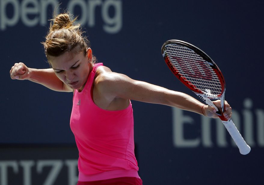Simona Halep, of Romania, reacts after a shot against Danielle Rose Collins, of the United States, in the first round during the opening round of the 2014 U.S. Open tennis tournament, Monday, Aug. 25, 2014, in New York. (AP Photo/Elise Amendola)