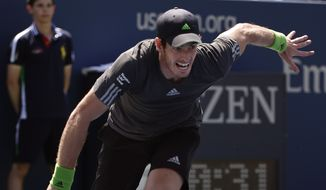 Andy Murray, of the United Kingdom, chases down a ball against Robin Haase, of the Netherlands, during the opening round of the 2014 U.S. Open tennis tournament, Monday, Aug. 25, 2014, in New York. (AP Photo/Kathy Willens)