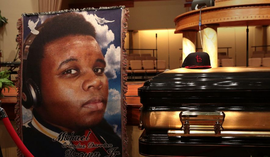 The casket of Michael Brown sits inside Friendly Temple Missionary Baptist Church awaiting the start of his funeral on Monday, Aug. 25, 2014. Brown, who is black, was unarmed when he was shot Aug. 9 in Ferguson, Mo., by Officer Darren Wilson, who is white.  Protesters took to the streets of  the St. Louis suburb night after night, calling for change and drawing national attention to issues surrounding race and policing. (AP Photo/St. Louis Post Dispatch, Robert Cohen, Pool) ** FILE **