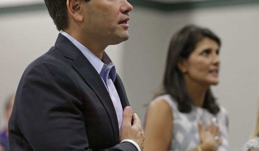 "Sen. Marco Rubio, R-Fla., front left, and South Carolina Gov. Nikki Haley, back right, recite the Pledge of Allegiance during the fourth annual ""Faith and Freedom BBQ"" hosted by U.S. Rep. Jeff Duncan in Anderson, S.C., Monday, Aug. 25, 2014. (AP Photo/Chuck Burton)"