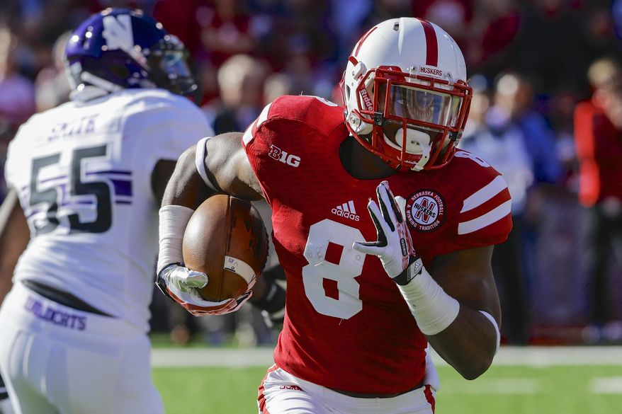 FILE - In this Nov. 2, 2013, file photo, Nebraska running back Ameer Abdullah (8) runs with the ball in the first half of an NCAA college football game against Northwestern in Lincoln, Neb. At a school that has a tradition of producing great running backs, Nebraska's Abdullah already is one of the greatest. (AP Photo/Nati Harnik, FIle)