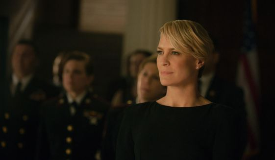 """This photo released by Netflix shows Robin Wright as Claire Underwood in season 2 of Netflix's """"House of Cards."""" (AP Photo/Netflix, Nathaniel E. Bell)"""