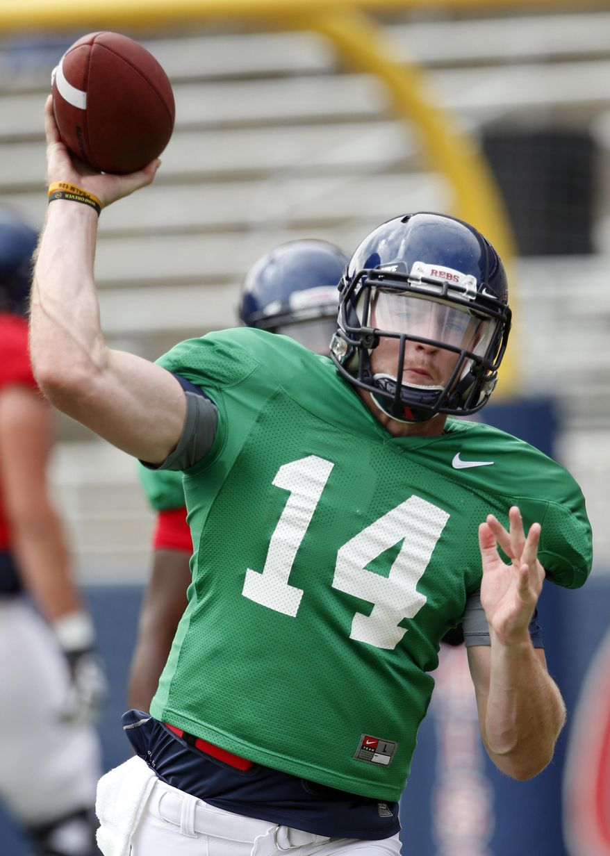 In this Aug. 9, 2014 photo, Mississippi quarterback Bo Wallace passes during the team's final open NCAA college football practice, in Oxford Miss. Wallace, now in his third year as the starter will be counted on to lead his team as they face Boise State in their season opener on Thursday, Aug. 28. (AP Photo/Rogelio V. Solis)