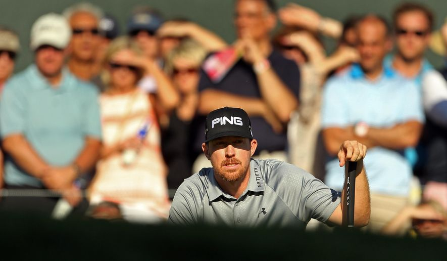 Hunter Mahan reacts lines up his putt on the 17th hole green during the final round of play at The Barclays golf tournament Sunday, Aug. 24, 2014, in Paramus, N.J. Mahan won the tournament. (AP Photo/Adam Hunger)