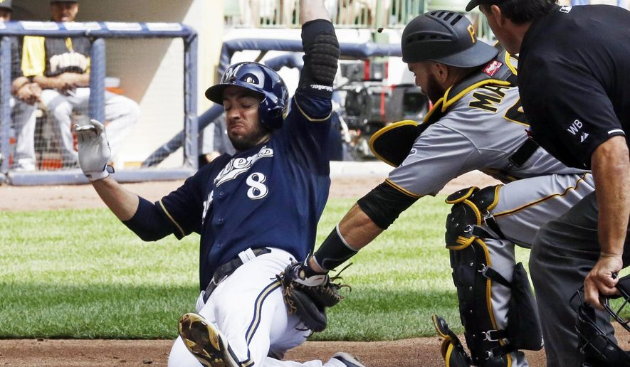 Pittsburgh Pirates catcher Russell Martin tags out Milwaukee Brewers' Ryan Braun, left, at home during the second inning of a baseball game Sunday, Aug. 24, 2014, in Milwaukee. Braun tried to score from second on a hit by Scooter Gennett. (AP Photo/Morry Gash)