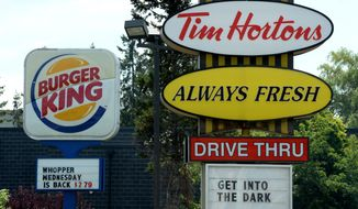 Burger King is in talks to buy Tim Hortons in hopes of creating a new, publicly traded company with its headquarters in Canada. The move would help the company avoid America's 40 percent corporate tax rate. (Associated Press)