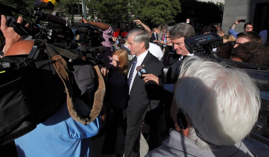 Former Virginia Gov. Bob McDonnell walks through a group of media representatives as he leaves the federal courthouse in Richmond, Virginia, Monday. (Associated Press)