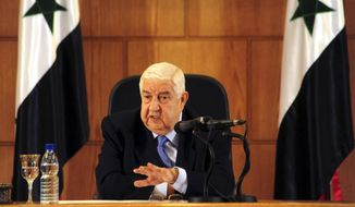In this photo released by the Syrian official news agency SANA, Syrian Foreign Minister Walid al-Moallem speaks during a press conference, giving the first public comments by a senior Assad official on the threat posed by the Islamic State group, in Damascus, Syria on Monday, August 25, 2014. Al-Moallem warned the U.S. not to conduct airstrikes inside Syria against the Islamic State group without Damascus' consent, saying any such attack would be considered an aggression. Al-Moallem also said that Syria is ready to work with regional states and the international community amid the onslaught of Islamic militants there and in Iraq, adding that the Syrian government is a crucial partner in the war on terror. (AP Photo/SANA)