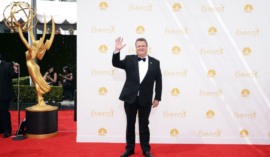 Eric Stonestreet arrives at the 66th Annual Primetime Emmy Awards at the Nokia Theatre L.A. Live on Monday, Aug. 25, 2014, in Los Angeles. (Photo by Jordan Strauss/Invision/AP)