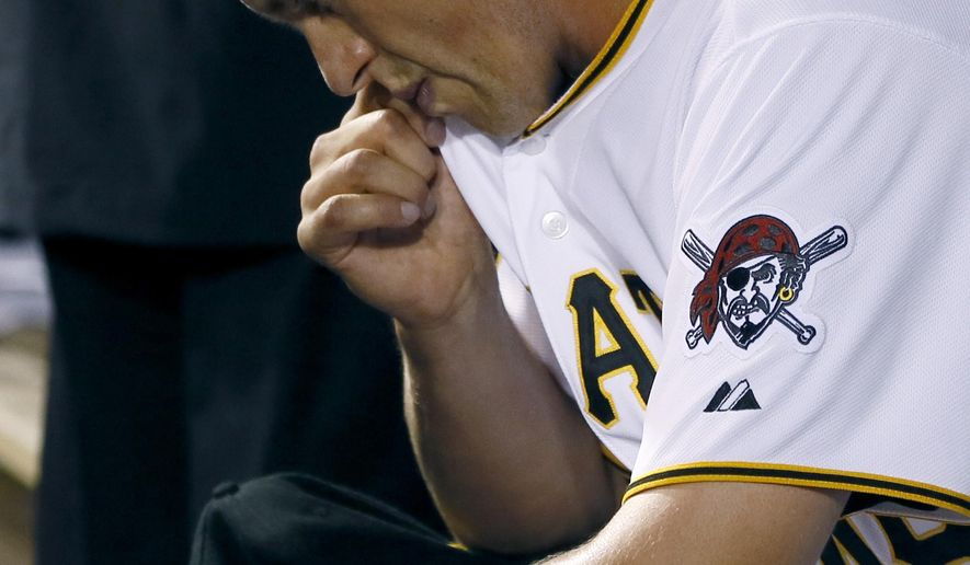 Pittsburgh Pirates relief pitcher Jared Hughes wipes his face as he sits in the dugout after being lifted in the seventh inning of a baseball game against the St. Louis Cardinals on Monday, Aug. 25, 2014, in Pittsburgh. Hughes got the loss as the Cardinals scored three in the seventh and won 3-2. (AP Photo/Keith Srakocic)