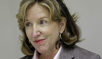 Sen. Kay Hagan, D-N.C., speaks with members of the media during a visit to greet supporters a campaign field office in Goldsboro, N.C., Monday, Aug. 25, 2014. (AP Photo/Gerry Broome)