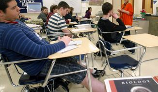 Jan Palmer, a biology teacher at Central High School in Aberdeen, S.D., top right, leads her Advanced Placement/Rising Scholars biology class through a practice test. (AP Photo/Aberdeen American News, Kevin Bennett, File)