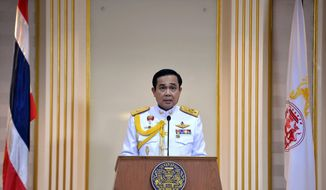 In this photo released by Thai Spokesman Office, Gen. Prayuth Chan-ocha speaks after he accepted a written royal command issued by King Bhumibol Adulyadej certifying his appointment as the country's 29th premier in Bangkok, Thailand Monday, Aug. 25, 2014. Thailand's junta leader, who seized power in a military coup three months ago, officially assumed his new post as prime minister on Monday following the endorsement from the country's monarch. (AP Photo/Thai Spokesman Office)