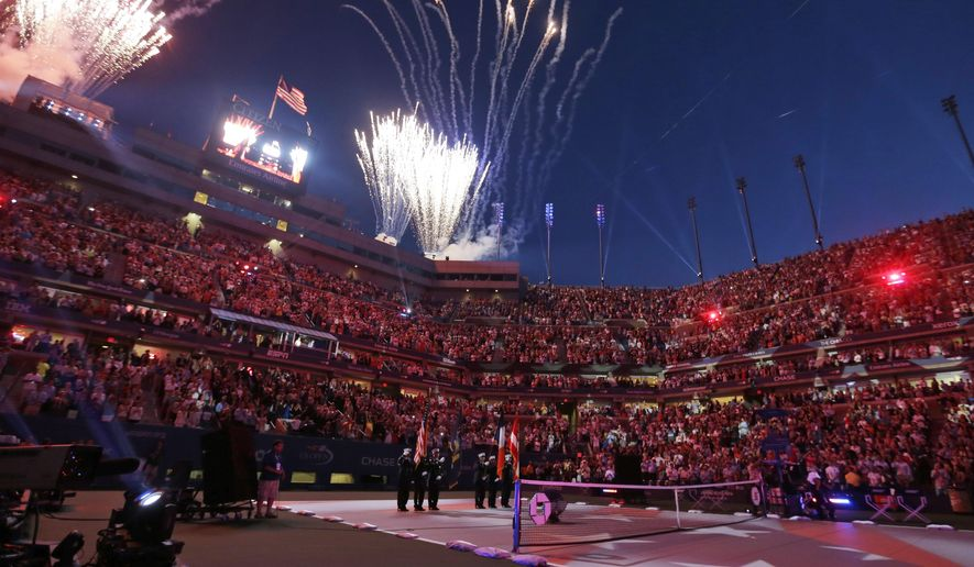 Fireworks go off over Arthur Ashe Stadium following the national anthem during the opening ceremony for the U.S. Open tennis tournament Monday, Aug. 25, 2014, in New York. (AP Photo/Darron Cummings)