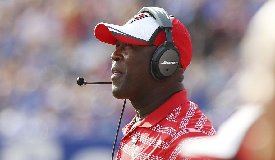 Tampa Bay Buccaneers head coach Lovie Smith watches his team play during the first half of a preseason NFL football game against the Buffalo Bills Saturday, Aug. 23, 2014, in Orchard Park, N.Y. The Buccaneers won the game 27-14. (AP Photo/Bill Wippert)