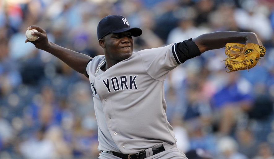New York Yankees pitcher Michael Pineda throws in the first inning of a baseball game against the Kansas City Royals at Kauffman Stadium in Kansas City, Mo., Monday, Aug. 25, 2014. (AP Photo/Colin E. Braley)