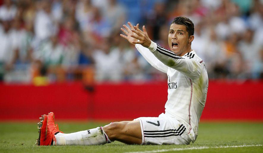 Real Madrid's Cristiano Ronaldo reacts during a Spanish La Liga soccer match between Real Madrid and Cordoba at the Santiago Bernabeu stadium  in Madrid, Spain, Monday, Aug. 25, 2014 . (AP Photo/Daniel Ochoa de Olza)