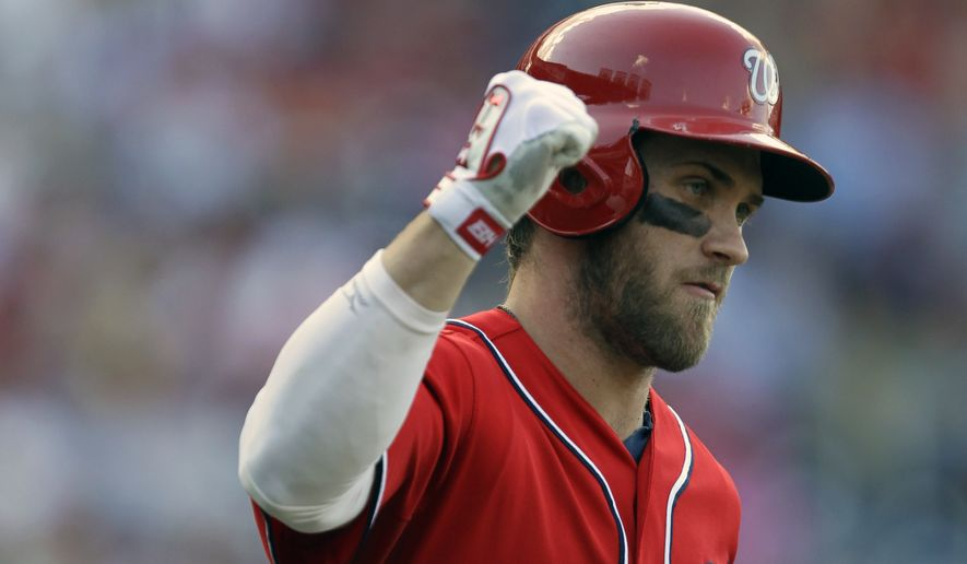 Washington Nationals' Bryce Harper celebrates his two-run home run as he approaches first base during the eighth inning of a baseball game against the San Francisco Giants, Sunday, Aug. 24, 2014, in Washington. The Nationals won 14-6. AP Photo/Luis M. Alvarez)